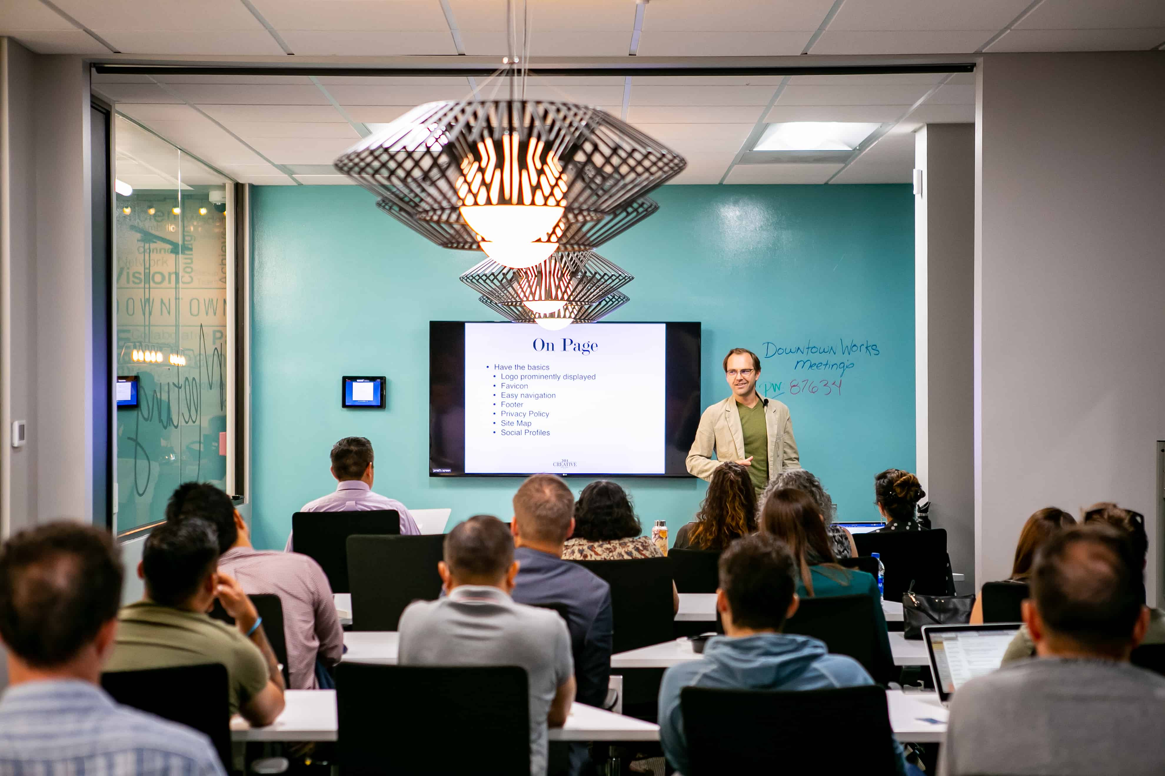 An SEO expert presents to a group of local business owners