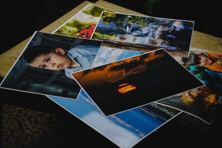 Various photo prints stacked in a pile